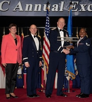 From left to right: Patricia M. Young, Air Force Materiel Command executive director; Maj. Gen. Carl Schaefer, AFMC deputy commander; Lt. Gen. Robert McMurry, AFMC commander; and Senior Airman Mutia Graham, Air Force Test Center; pose for a photo during AFMC's Annual Excellence Awards Banquet March 6, 2019, at Wright-Patterson Air Force Base, Ohio. McMurry presented Graham with a trophy for being selected as the command's Airman of 2018. (U.S. Air Force photo by Michelle Gigante)