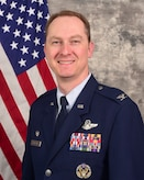U.S. Air Force Col. Christopher Holland pins on the rank of colonel.