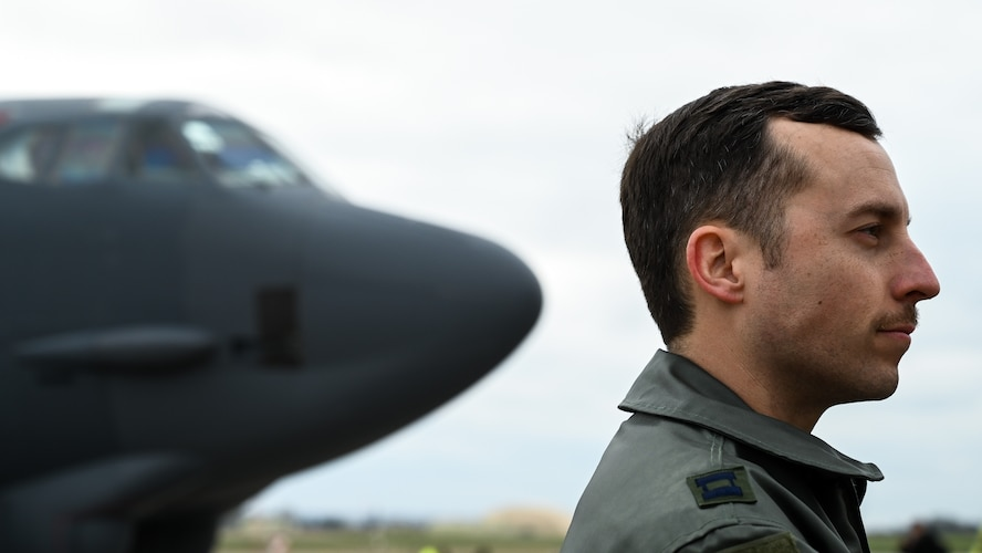 Capt. Matt Sandridge, 20th Bomb Squadron pilot deployed from Barksdale Air Force Base, La., stands on the flight line during a press conference at RAF Fairford, March 19, 2019. The deployment of strategic bombers to the U.K. helps exercise RAF Fairford as U.S. Air Forces in Europe's forward operating location for bombers and includes joint and allied training in the U.S. European Command theater to improve U.S. and allied interoperability. (U.S. Air Force photo by Airman 1st Class Tessa B. Corrick)