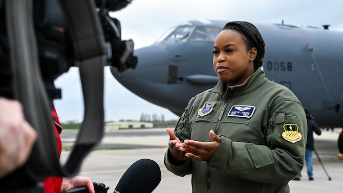 Capt. Austyn Wilson, 20th Bomb Squadron weapons system officer deployed from Barksdale Air Force Base, La., is interviewed by a local media outlet during a press conference at RAF Fairford, March 19, 2019. The deployment of strategic bombers to the U.K. helps exercise RAF Fairford as U.S. Air Forces in Europe's forward operating location for bombers and includes joint and allied training in the U.S. European Command theater to improve U.S. and allied interoperability. (U.S. Air Force photo by Airman 1st Class Tessa B. Corrick)