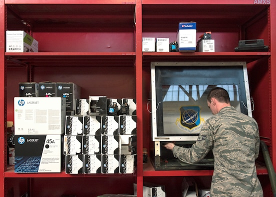 "U.S. Air Force Staff Sgt. Tyler Ferris,  92nd Maintenance Group Air Force Repair Enhancement Program technician, prepares to refill an ink cartridge at Fairchild Air Force Base, Washington, March 20, 2019. The AFREP team has contributed toward the ""Green in 19"" initiative by implementing environmentally friendly practices through recharging ink cartridges to mitigate the many adverse effects of just throwing them away. (U.S. Air Force photo by Airman 1st Class Whitney Laine)"