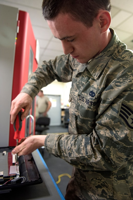 U.S. Air Force Staff Sgt. Tyler Ferris, 92nd Maintenance Group Air Force Repair Enhancement Program technician, repairs a computer monitor at Fairchild Air Force Base, Washington, March 20, 2019. AFREP has collected desktop monitors from across the base to repair and distribute back into workstations. Each one cuts costs, time and doesn't add to a growing pile of electronics waste that is a growing ecological issue in an ever more technological world. (U.S. Air Force photo by Airman 1st Class Whitney Laine)