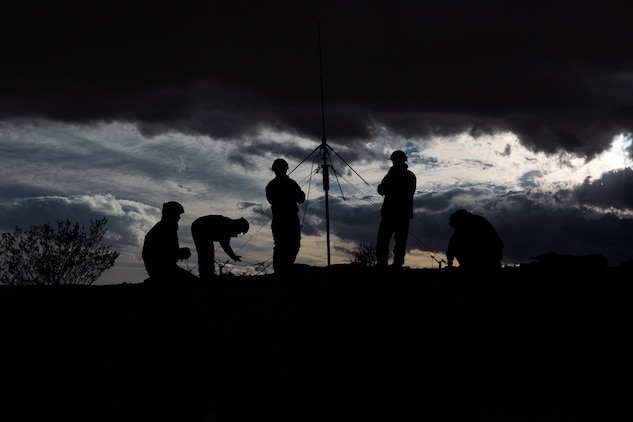 Japan Ground Self-Defense Force soldiers set up an antenna for the tactical operations center at the National Training Center, Fort Irwin, Calif., Feb. 15, 2019.