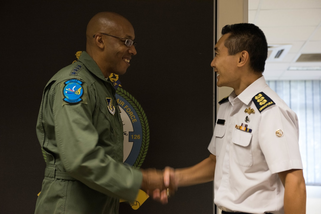 U.S. Air Force Gen. CQ Brown, Jr., Pacific Air Forces commander, shakes hands with Singapore Air Force Col. Sherman Ong, Command Helicopter Group, after a visit to Sembawang Air Base, Singapore, March 19, 2019.