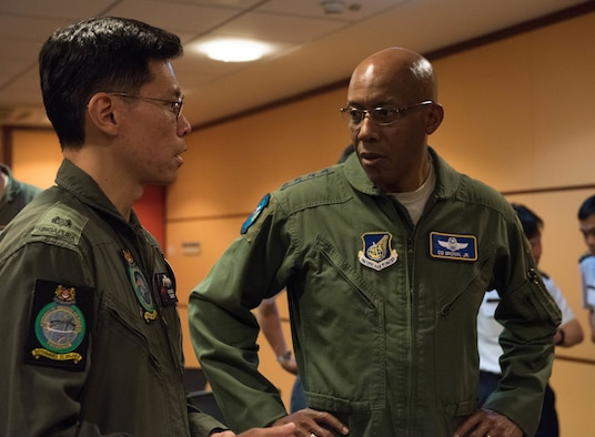 U.S. Air Force Gen. CQ Brown, Jr., Pacific Air Forces commander, talks with a member of the Singapore Air Force during a visit to Changi Air Base, Singapore, March 19, 2019.