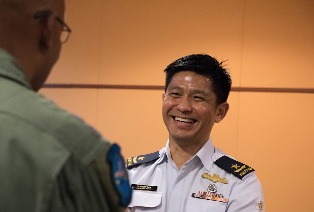 U.S. Air Force Gen. CQ Brown, Jr., Pacific Air Forces commander, talks with Singapore Air Force Brig. Gen. Tommy Tan Ah Han, Chief of Staff (Air Staff), during a visit to Changi Air Base, Singapore, March 19, 2019.