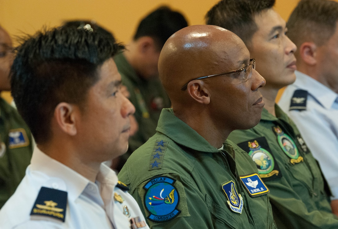 U.S. Air Force Gen. CQ Brown, Jr., Pacific Air Forces (PACAF) commander, receives a briefing during his visit to Changi Air Base, Singapore, March 19, 2019.