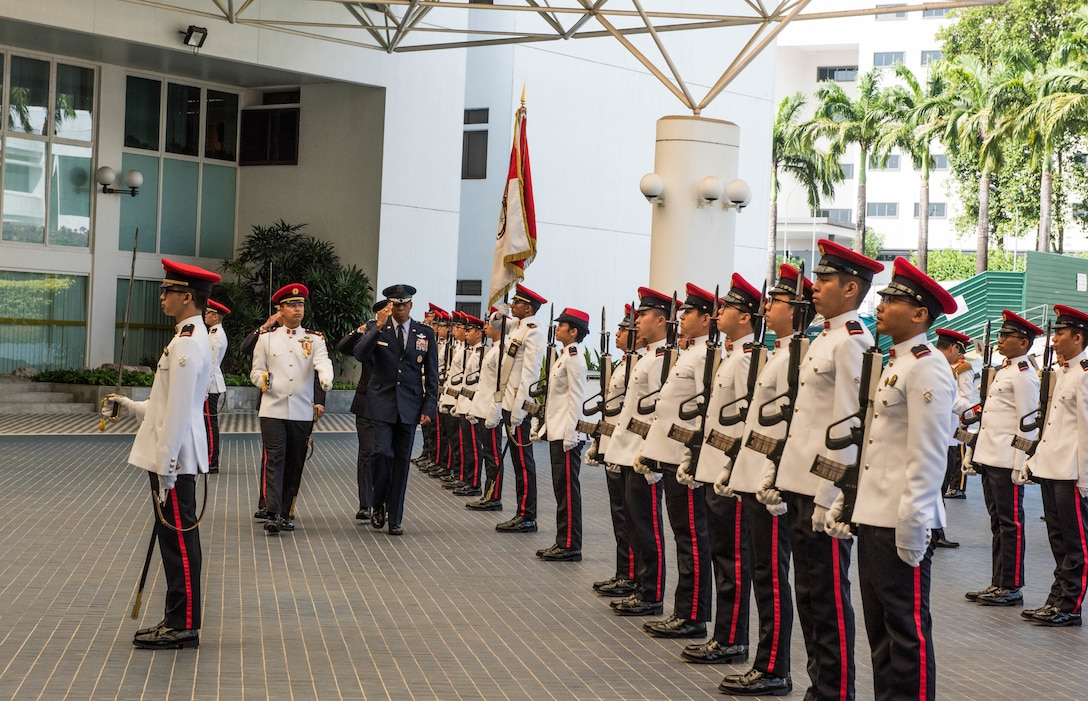 U.S. Air Force Gen. CQ Brown, Jr., Pacific Air Forces commander, salutes during the Guard of Honor at the Ministry of Defence, Singapore, March 20, 2019.