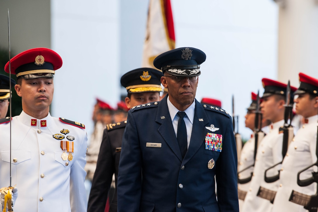 U.S. Air Force Gen. CQ Brown, Jr., Pacific Air Forces commander, conducts a review of the Guard of Honor during a visit to the Ministry of Defence, Singapore, March 20, 2019.