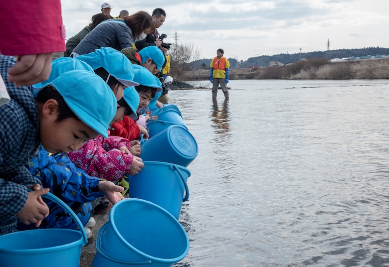 Children release baby salmon into the Oirase River for the 22nd Annual Baby Salmon Release at Shimoda Salmon Park, Japan, March 16, 2019. The baby salmon released during this event were bred from last season's salmon catch. After living three to five years in the Northern Sea, the fish find their way back to the river to create future generations.