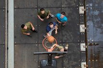 U.S. Marines with the 22nd Marine Expeditionary Unit play basketball in the well deck of the Whidbey Island-class dock landing ship USS Fort McHenry. In their free time, Marines played basketball for fun and to improve physical fitness. Marines and Sailors with the 22nd MEU and Kearsarge Amphibious Ready Group are currently deployed to the U.S. 5th Fleet area of operations in support of naval operations to ensure maritime stability and security in the Central Region, connecting the Mediterranean and the Pacific through the western Indian Ocean and three strategic choke points.