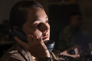 Senior Airman Anelle Orrell, 379th Air Expeditionary Wing command post controller, gathers information for distribution March 18, 2019, at Al Udeid Air Base, Qatar. Airmen from the command post are responsible for gathering and relaying information to entities across base to include aircraft maintenance requirements, security forces incidents, and notifications that ensure the safety of Airmen and other assets on base. (U.S. Air Force photo by Tech. Sgt. Christopher Hubenthal)