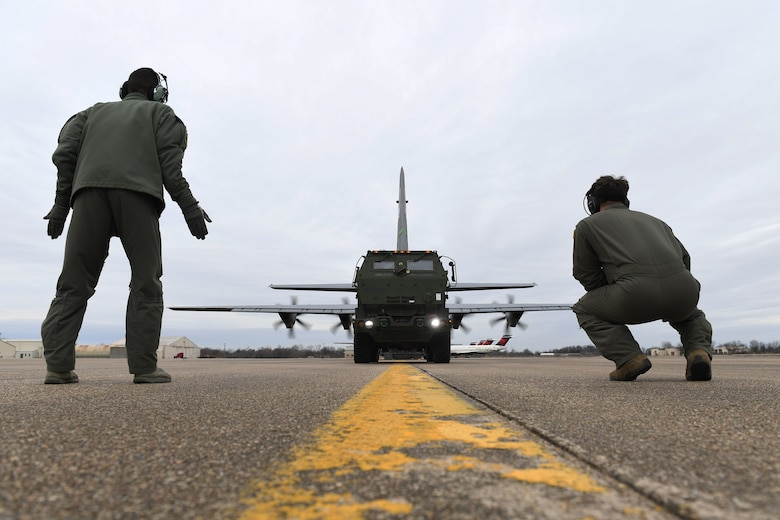 Airmen  load a M142 High Mobility Artillery Rocket System onto a C-130J