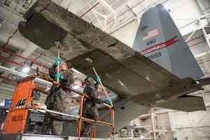 Airmen wash a C-130H Hercules