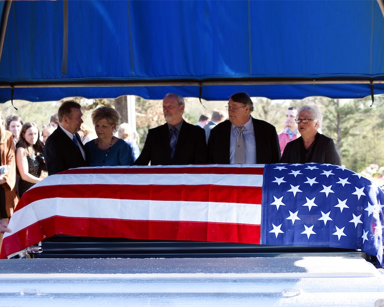 The sons and daughters of John Cockerham, a local World War II veteran, stand by his casket March 16, 2019, at Center Hill Baptist Church Cemetery in Hamilton, Mississippi. At the funeral, members from the Columbus Air Force Base Honor Guard performed a rifle salute, played taps, folded and presented an American flag to his wife, Georgia Mae. (U.S. Air Force photo by Sharon Ybarra)