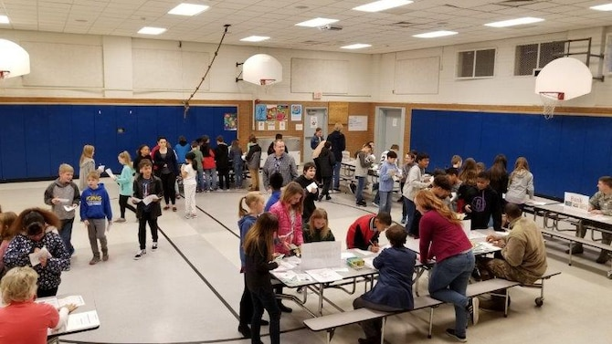 Students during a workshop called Kids Marketplace March 12, 2019, at Hill Field Elementary to learn the importance of budgeting and saving. The activity was overseen by the Airman and Family Readiness Center an Utah State University Extension. (Courtesy photo)