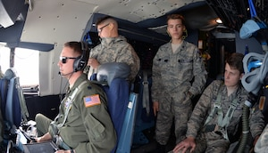 Civil Air Patrol cadets, Cadet Senior Airman Allen Doroshko, Cadet Airman Basic Caleb Wood, and Cadet Lt. Col. Jackson Baker, observe operations on the flight deck during an incentive flight over West Texas March 12, 2019.