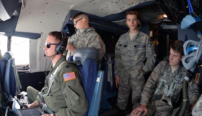 Civil Air Patrol cadets, Cadet Senior Airman Allen Doroshko, Cadet Airman Basic Caleb Wood, and Cadet Lt. Col. Jackson Baker, observe operations on the flight deck during an incentive flight over West Texas March 12, 2019.