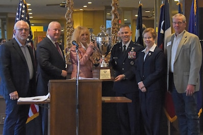 San Angelo Mayor Brenda Gunter, joined by San Angelo civic leaders, receives the Air Education and Training Command Altus Trophy from U.S. Air Force Lt. Gen. Steve Kwast, commander of AETC, at the dinner for San Angelo and Goofellow leaders at the Riverview Restaurant in San Angelo, Texas, March 20, 2019. The Altus Trophy is presented annually to the community with the strongest ties to their AETC base. (U.S. Air Force photo by Senior Airman Seraiah Hines/Released)