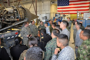 Staff Sgt. Luis Velez, 837th Training Squadron international logistics training flight instructor (third from left), translates English to Spanish while Senior Airman Alexander Alvillar and Master Sgt. Sean Preston, propulsion mechanics, describe features of a C-5M Super Galaxy engine to Inter-American Air Forces Academy students and instructors March 18, 2019 at Joint Base San Antonio-Lackland, Texas.