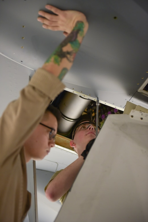 Airman Ty Roberts, 22nd Maintenance Squadron crew chief, removes a screw on a KC-46A Pegasus wing panel, while Staff Sgt. Benjamin Daley, 22nd MXS crew chief, holds the panel in place March 20, 2019, at McConnell Air Force Base, Kan. Maintenance Airmen performed the first A-check inspection on the Air Force's first KC-46. (U.S. Air Force photo by Staff Sgt. Chris Thornbury)