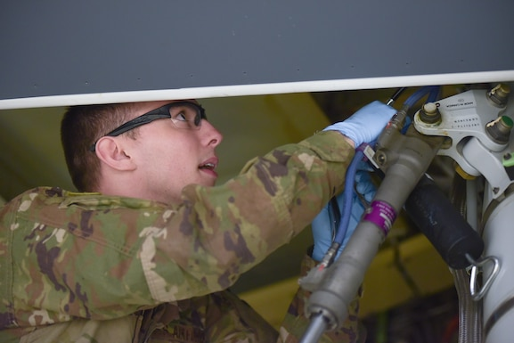 Staff Sgt. Ralph D'Ambrosio III, 22nd Aircraft Maintenance Squadron KC-46A Pegasus work manager, lubricates a forward trunnion bearing March 20, 2019, at McConnell Air Force Base, Kan. It is estimated that the first A-check will be between 240 and 320 work hours based on initial training. (U.S. Air Force photo by Staff Sgt. Chris Thornbury)