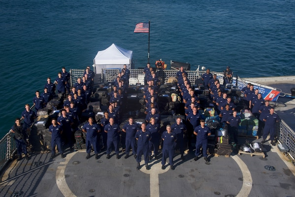Pictured is the Coast Guard Cutter Tampa (WMEC-902) crew standing among approximately 27,000 pounds of seized cocaine Mar. 22, 2019 at Coast Guard Base Miami Beach.