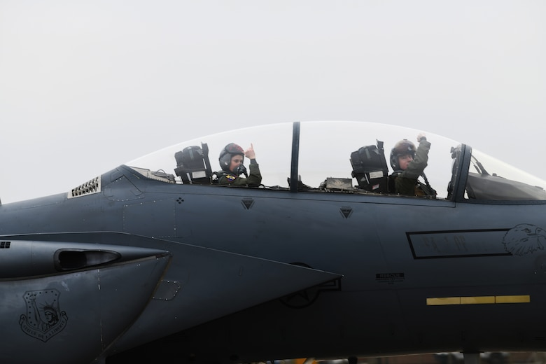 F-15E Strike Eagle aircrew assigned to the 494th Fighter Squadron prepare to take off  for exercise Point Blank at Royal Air Force Lakenheath, England, March 22, 2019. U.K. ground controllers integrated with U.S. aircraft during a large force exercise for the first time, continuing the existing readiness training partnership between the two nations. (U.S. Air Force photo by Airman 1st Class Shanice Williams-Jones)