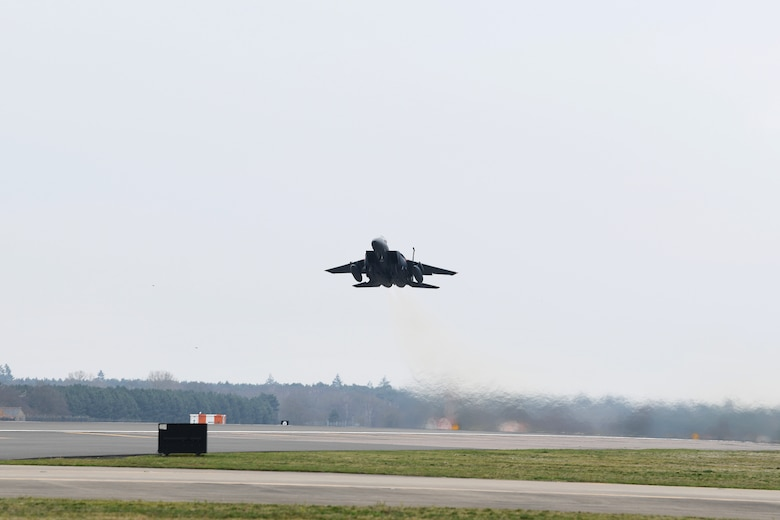 An F-15E Strike Eagle takes off to participate in exercice Point Blank at Royal Air Force Lakenheath, England, March 22, 2019. Point Blank is a recurring, low-cost exercise initiative designed to increase tactical proficiency of U.S. Air Forces in Europe – Air Forces Africa and Ministry of Defence forces. (U.S. Air Force photo by Airman 1st Class Shanice Williams-Jones)