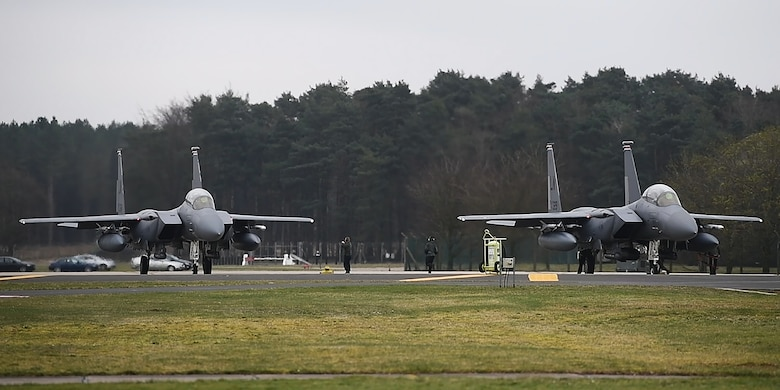 48th Fighter Wing F-15E Strike Eagles prepare to take off to participate in exercise Point Blank at Royal Air Force Lakenheath, England, March 22, 2019. Alongside F-15E Strike Eagles assigned to the 492nd and 494th Fighter Squadrons, RAF Typhoon, Hawk and F-35B Lightning jets also participated. (U.S. Air Force photo by Airman 1st Class Shanice Williams-Jones)