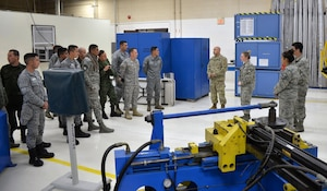 Staff Sgt. Sarah Anderson, 433rd Maintenance Squadron aircraft structural mechanic (third from right), explains to Inter-American Air Forces Academy students how personnel in the metals shop create replacement aircraft parts March 18, 2019 at Joint Base San Antonio-Lackland, Texas.