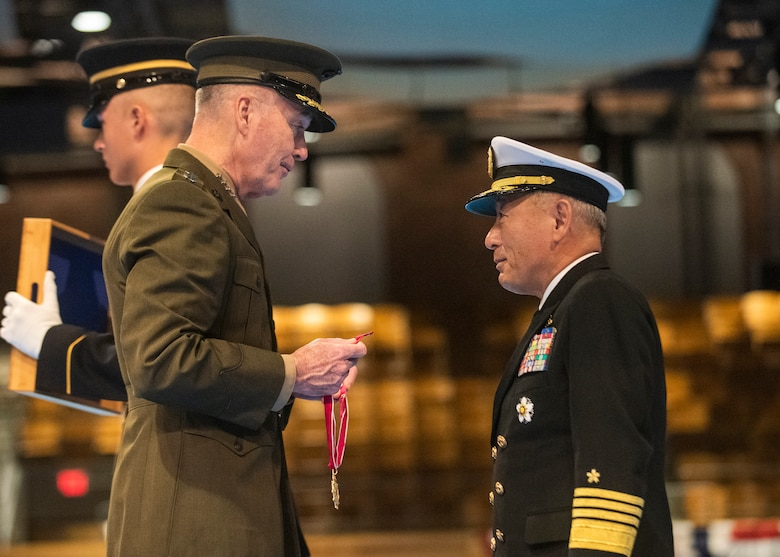 Marine Corps Gen. Joe Dunford, chairman of the Joint Chiefs of Staff, hosts an Armed Forces full honor arrival ceremony for Japan Maritime Self-Defense Force Adm. Katsutoshi Kawano, chief of staff, Joint Staff, Japan Self-Defense Forces on Joint Base Myer-Henderson Hall, March 21, 2019.
