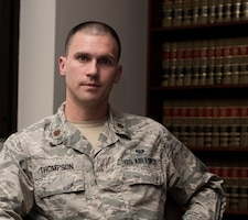 Maj. Matt Thompson, the deputy staff judge advocate assigned to the 509th Bomb Wign Legal Office, poses for a portrait on March 12, 2019, at Whiteman Air Force Base, Missouri. Thompson won the Global Strike Command Young JAG award for 2018 for his dedication and accomplishments as the deputy SJA at Whiteman. (U.S. Air Force photo by Staff Sgt. Kayla White)