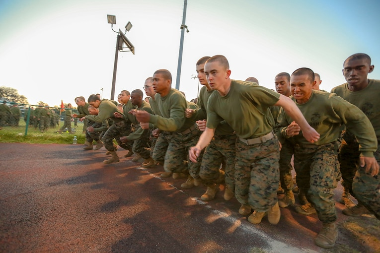 Marine Corps recruits prepare for a combat fitness test.