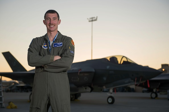 U.S. Air Force Capt. Kyle Benham, 62nd Fighter Squadron (FS) F-35A Lightning II fighter jet pilot, stands in front of an F-35A at Nellis Air Force Base, Nev., March 18, 2019. Benham participated in his first Red Flag at Nellis to improve combat readiness as a pilot with a multitude of different partners. (U.S. Air Force photo by Airman 1st Class Bryan Guthrie)