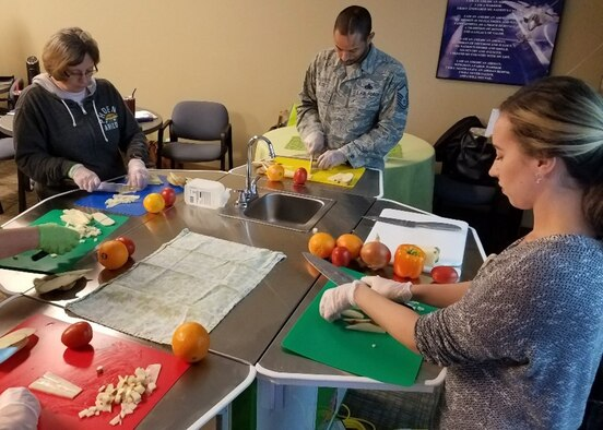 Attendees of a food demonstration training course practice preparing fresh vegetables Feb. 8, 2019, at Luke Air Force Base, Ariz.