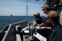 190321-N-IO414-1052 SOUTH CHINA SEA (March 21, 2019) Sailors translate flashing-light Morse code received from Philippine Navy vessel BRP Ramon Alcaraz (FF 16) aboard the Avenger class mine countermeasures ship USS Chief (MCM 14) during a maritime cooperative activity. Chief, part of Mine Countermeasures Squadron 7, is operating in the Indo-Pacific region to enhance interoperability with partners and serve as a ready-response platform for contingency operations. (U.S. Navy photo by Mass Communication Specialist 2nd Class Jordan Crouch)