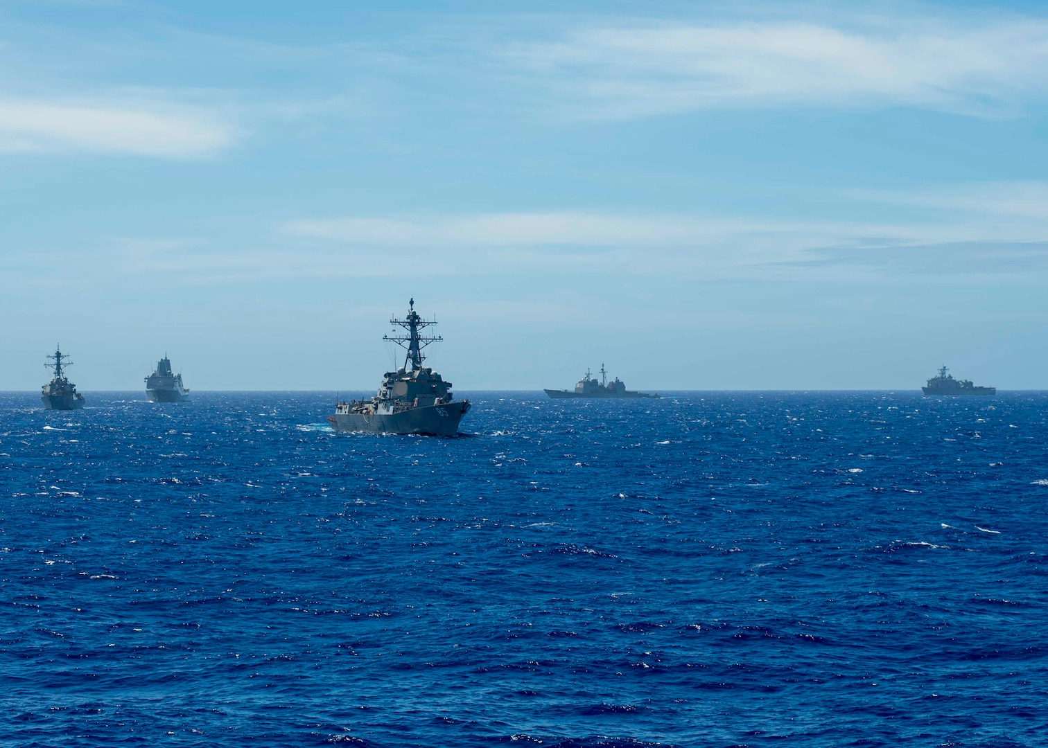 190314-N-WK982-2032 PHILIPPINE SEA (March 14, 2019) The Arleigh Burke-class guided-missile destroyer USS McCampbell (DDG 85), the Arleigh Burke-class guided-missile destroyer USS Milius (DDG 69), the amphibious transport dock ship USS Green Bay (LPD 20), the Ticonderoga-class guided-missile cruiser USS Chancellorsville (CG 62), and the amphibious dock landing ship USS Ashland (LSD 48) maneuver while operating in the Philippine Sea. U.S. Navy warships train together to increase the tactical proficiency, lethality, and interoperability of participating units in an Era of Great Power Competition. (U.S. Navy photo by Mass Communication Specialist 2nd Class John Harris/Released)