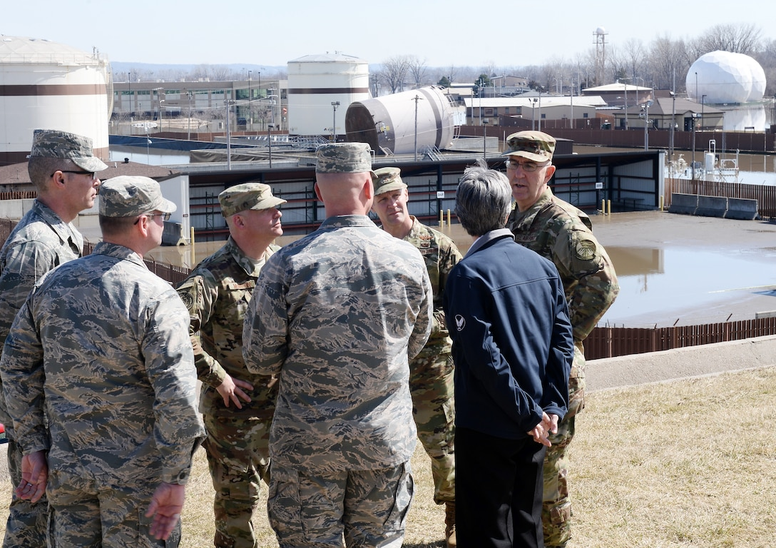 U.S. Strategic Command Commander Gen. John Hyten talks with Secretary of the Air Force Heather Wilson March 22, 2019, on Offutt Air Force Base, Neb. A week earlier the base began taking on flood waters that eventually covered one-third of the installation. (U.S. Air Force photo by Charles Haymond)