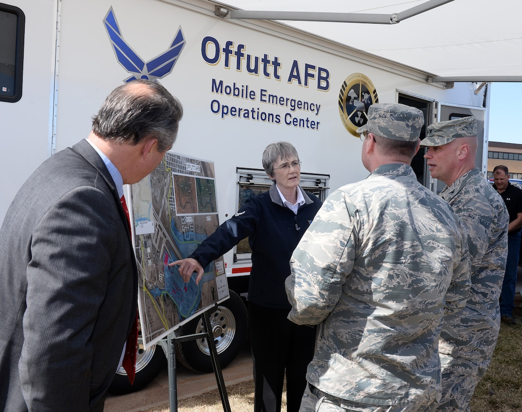 Secretary of the Air Force Heather Wilson talks to 55th Wing leadership as Rep. Don Bacon looks on during her visit to Offutt Air Force Base, Nebraska, March 22, 2019. Team Offutt is in the recovery phases from an historic flood which began to creep onto the installation March 15. (U.S. Air Force photo by Charles Haymond)