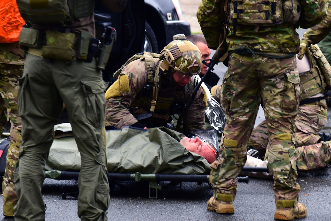 A 57th Rescue Squadron Guardian Angel pararescueman, stationed at Aviano Air Base, Italy, stabilizes a simulated causality during a Non-combatant Evacuation Operation exercise at the Police Academy, Croatia, March 18, 2019. The 31st Fighter Wing and the 352nd Special Operations Wing, RAF Mildenhall, England, partnered with the government of Croatia and the U.S. Embassy Zagreb to test their abilities to plan and execute emergency response during a crisis.  (U.S. Air Force photo by Senior Airman Kevin Sommer Giron)