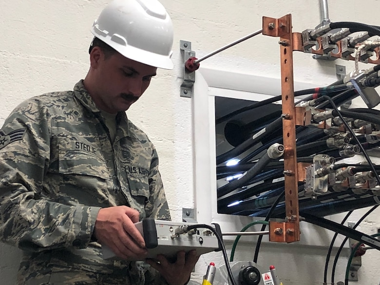 U.S. Air Force Senior Airman Shane Stedje, 210th Engineering Installation Squadron, tests a voltage standing wave ratio at Tyndall Air Force Base, Nov. 30, 2018.