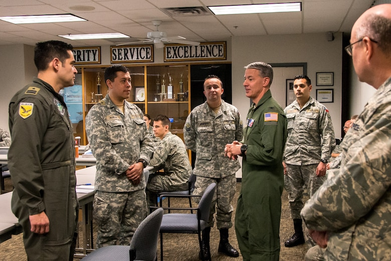 Texas Air National Guard Col. Thomas M. Suelzer, 136th Airlift Wing commander, speaks with Chilean Air Force Airmen July 26, 2018, at Naval Air Station Fort Worth Joint Reserve Base, Texas. The Chilean Air Force visited the wing as part of the State Partnership Program, which forges mutually beneficial partnerships with some of our staunchest allies and partners worldwide. (U.S. Air National Guard photo by Tech. Sgt. Lynn Means)