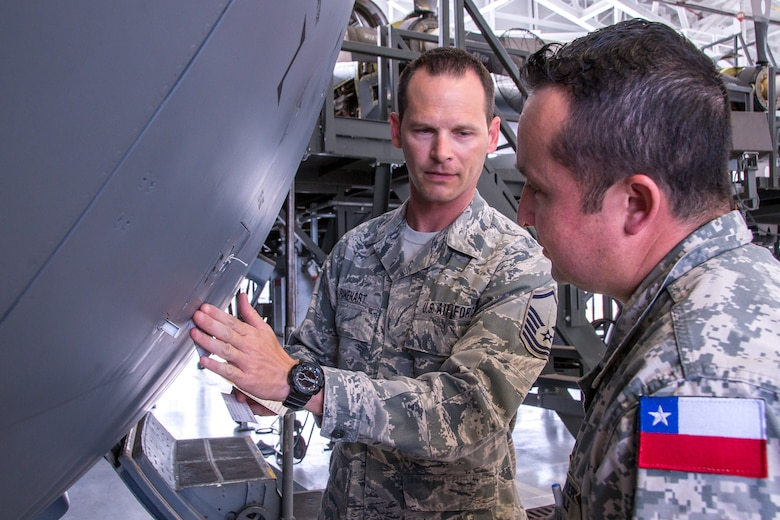 Texas Air National Guard Master Sgt. Jonathan D. Rinehart an aircraft maintainer with the 136th Maintenance Squadron, briefs Chilean Air Force explaining the isochronal inspection process and associated work cards to Chilean Air Force Staff Sergeant Cristian Venegas, a 10th Chilean Aviation Group expediter, July 26, 2018, at Naval Air Station Fort Worth Joint Reserve Base, Texas. The Chilean Air Force visited the 136th Airlift Wing as part of the State Partnership Program, which forges mutually beneficial partnerships with some of the Wing's staunchest allies and partners worldwide. (U.S. Air National Guard photo by Tech. Sgt. Lynn Means)