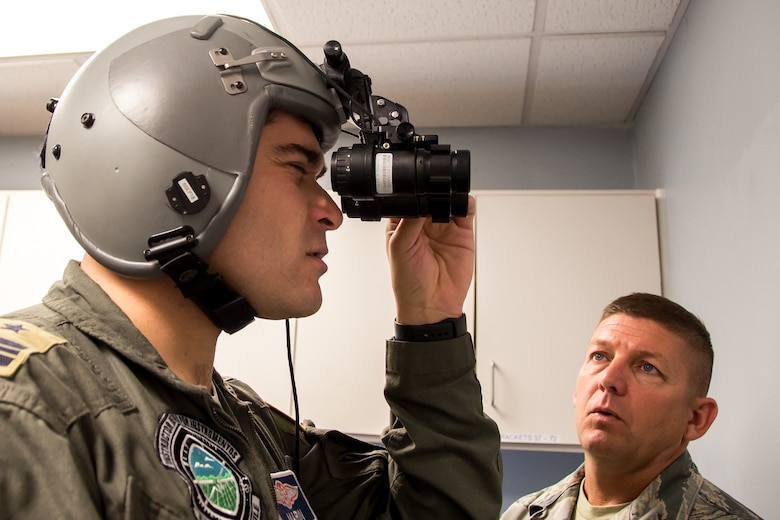 Chilean Air Force Major F. Marin, a C-130 pilot with the N10 Squadron, lines up the lenses on night vision goggles July 24, 2018, at Naval Air Station Fort Worth Joint Reserve Base, Texas. Marin visited the wing as part of the State Partnership Program, which forges mutually beneficial partnerships with some of the 136th Airlift Wing's staunchest allies and partners worldwide. (U.S. Air National Guard photo by Tech. Sgt. Lynn Means)