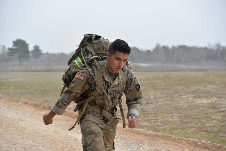 Spc. Juan Gonzalez, Texas Army National Guard, pushes himself to the finish line to complete the 12-mile ruck march wearing a 35-pound ruck sack during the Texas National Guard's 2019 Best Warrior Competition at Camp Swift March 1, 2019. The competition is currently putting the competitors through demanding physical and mental tests which include a modified Army physical fitness test, an obstacle course, marksmanship drills, land navigation, formal board interviews, written exams, and a mystery event. (Texas Air National Guard photo by Senior Airman Bryan Swink)