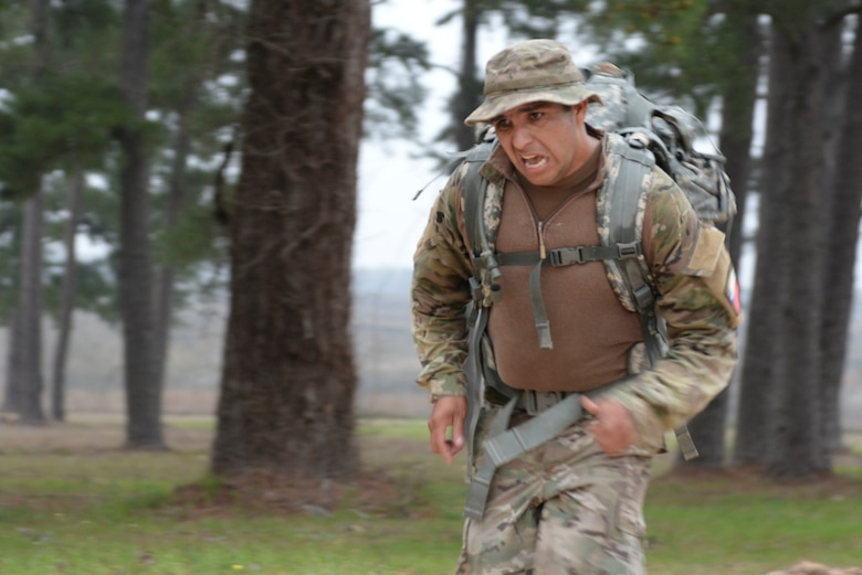 Sgt. Mayquel Garcia, Chilean Army, sprints to the finish line carrying a 35-pound ruck sack completing the 12-mile ruck march to begin day three of the Texas National Guard's 2019 Best Warrior Competition at Camp Swift March 1, 2019. The four-day event not only features some of the state's top Soldier and Airmen, but also features competitors from Chile and the Czech Republic, who are both partners of the Texas military under the State Partnership Program. (Texas Air National Guard photo by Senior Airman Bryan Swink)