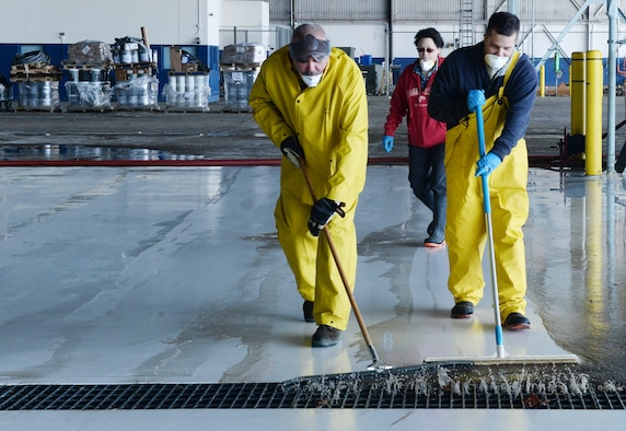 Team Offutt members clear debris from one of the docks at the Bennie L. Davis Maintenance Facility on March 21, 2019. Team Offutt personnel have regained access to buildings and facilities to begin assessing damage and recovering items which were underwater less than a week ago (Photo by Charles Haymond).