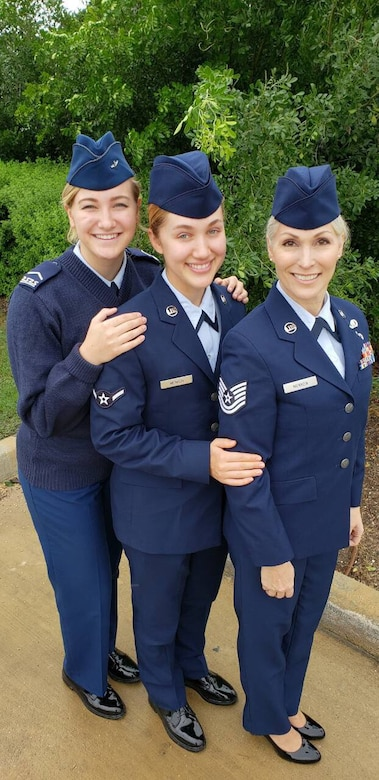 U.S. Air Force Tech. Sgt. Lisa. Menken, a contract specialist with the 136th Mission Support Group, Cadet Staff Sgt. Savannah C. Menken a student at the Air Force Academy, and Airman Charissa A. Menken, a student with the 136th Airlift Wing, pose together for a photo Dec. 27, 2018, at Naval Air Station Fort Worth Joint Reserve Base, Texas.