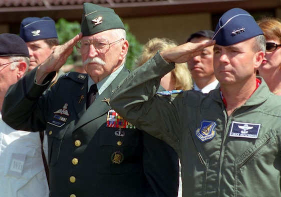 Col. Lewis Millett and Lt. Gen. Charles Heflebower, prior 7th Air Force commander, salute during a Hill 180 ceremony in February 2000. Team Osan pays tribute to the soldiers of the 27th Infantry Regiment annually, whose heroic actions helped secure the freedom of South Koreans during the Korean War in 1951. Millett received the Medal of Honor after the battle. (Courtesy photo)